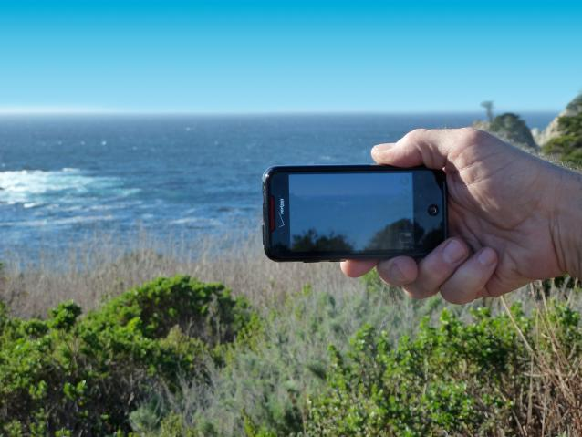 photo of person holding up cell phone at Point Lobos